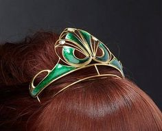 The art nouveau piece from the previous pin, worn.
