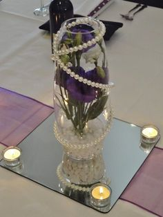 Erin's Ever After Blog Wedding table centerpieces lisianthus flowers purple and white pearls