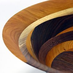 A beautiful crafted cherry and black walnut wood art bowl with very slender sidewalls. exclusive swirl design with striking grain patterning
