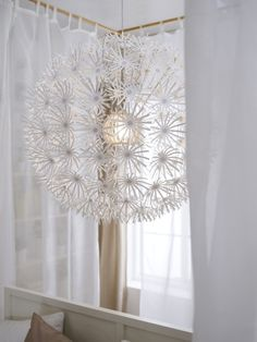 The IKEA PS MASKROS pendant lamp imitates a dandelion ready to be scattered by the wind. And when lit, the shadows on the walls resemble just that - the room dissolves and transforms!