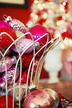 Love the thought of vintage ornaments in an old wire basket.  Must do one for this Christmas.