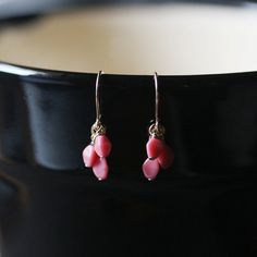 On these sweet earrings, three pink pressed glass beads dangle from each 14k French gold-filled earwire. This design is the more minimalist version
