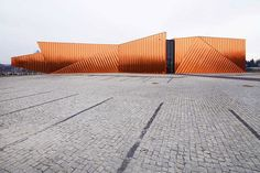 When OVO Grąbczewscy Architekci in Poland was asked to create the city of Żory's museum, it took a cue from the name Żory, which means fire. Three independent walls are covered with copper plates, designed to look like dancing flames. Covered in a high-resistance varnish, the façade will never patina, keeping its fiery appearance forever.