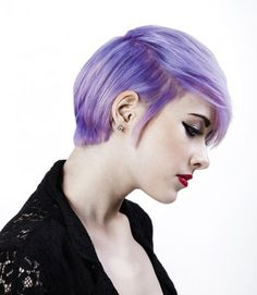 Short side swept pixie hairstyle with purple colouring