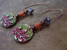 """Celebrate the beauty of autumn with handcrafted oak leaf charms swaying beneath Czech glass beads, copper wire and a tiny loops of copper chain. Copper earwires are hammered for strength. If you have metal sensitivities I can switch the earwires to sterling silver, leave a note when you check out if prefer silver. This design is a one-of-a-kind design. Earrings measure 1 3/4"""" long."""