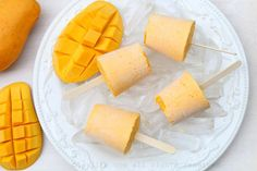 Mango yogurt popsicles {Helados de mango y yogurt} made with plain yogurt, ripe mangoes, and honey to taste. These creamy fruit popsicles are inspired by the traditionalist batidos de yogurt that you find in Ecuador. Eggless Desserts, Cold Desserts, Delicious Desserts, Yummy Food, Yummy Recipes, Mango Popsicles, Yogurt Ice Cream, Plain Yogurt, Mango Cream