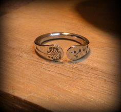 Dandelion ring, stamped forged, sterling silver. $34.00, via Etsy. as soon as I figure out my ring size this will be mine :o) matches new tat