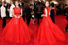 THE HIT-OR-MISS: Waist up, we love Allison Williams in this Giambattista Valli gown. The colour is glorious and somehow doesn't make her look like part of the carpet, and the contrasting beading and brooch add a real vintage air. Waist down, however, the frothy tent of tulle does swamp her figure in a sort of human Weeble way. However it does look better from the back ... if the section from the waist to the netting had been a tad more fitted, flaring into a dramatic fishtail, we'd call this…