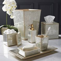 The intricate design of our Miraflores Bath Accessories is painted by hand on mirrored glass panels, and mounted on wood. An intricate finishing          process creates the dazzling sparkle effect.                              Made by Labrazel                                Each piece is hand-painted                                   Offered in 3 finishes: ivory, gold, and silver                                  View recommendations for care and cleaning                            ...