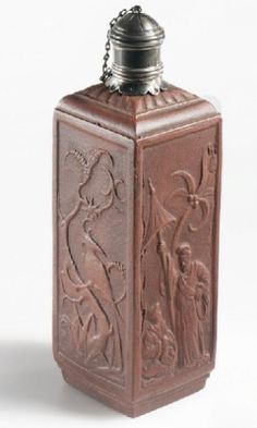 'A STAFFORDSHIRE REDWARE CHINOISERIE RECTANGULAR SMALL TEA-JAR, two sides moulded with figures beneath a stylised palm-tree alternating with an exotic bird perched on a tree issuant from rockwork, the shoulder with a band of gadrooned ornament late 17th century, Elers Brothers 9.5cm. high