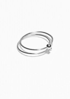 Crafted from high quality sterling silver, this refined double-ring has a timeless design, featuring two thin rings that are attached to each other with sterling silver drops.   Please note:  your delicate treasure longer by avoiding contact with creams and perfumes, keeping it away from heat and moisture and storing it wisely in a box or bag.
