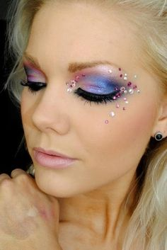 Pretty blue to pink gradient eye shadow and an awesome example of randomly placing crystals to enhance the eyes!