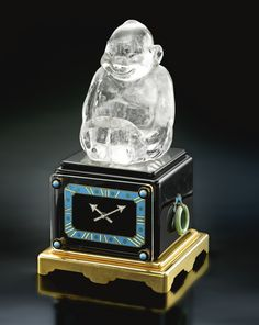 CARTIER/EUROPEAN WATCH & CLOCK CO., INC. 'THE BILLIKEN' AN IMPORTANT AND UNIQUE ROCK CRYSTAL, ONYX, GOLD AND ENAMEL DIAMOND-SET EIGHT-DAY DESK TIMEPIECE CIRCA 1922 NO 747.