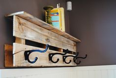 Pallet coat hook! This would be so easy to make and paint to fit the room.