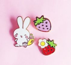 ***IM ON VACATION! PLEASE NOTE ALL ORDERS PLACED BETWEEN DEC. 22 AND JAN. 9 WILL SHIP AFTER JAN. 10, 2017***   Adorable set of one Bunny, one red, and one pink strawberry pins (three pins in total). This adorable set will make you happy and hoppy every time you wear it! Jewel-quality hard enamel pins, especially designed for the young at heart.  Materials: cloisonné/ hard enamel, and a whole lotta love Gold plating Bunny Size: 1.25 Pink Strawberry: 0.75 (approx.) Red Strawberry with Flow...