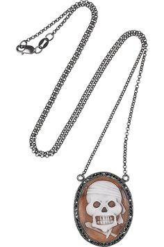 Oxidized silver, sardonyx shell and black dimaond skull cameo!!  SO punk!  LOVE it!