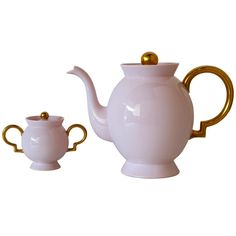 Porcelain Tea Set by Gio Ponti  Germany / Italy  late 1920s  A tea / coffee pot and a sugar bowl in fantastic pink porcelain with 24 ct. gold-plated decoration. This service was designed by Gio Ponti for Richard-Ginori, where Ponti served as director of design for much of the 1920s and 1930s. In 1924, the Johann Haviland factory in Bavaria was bought by Richard-Ginori, and they produced some of Richard-Ginori's products there for the Northern European market, including these two pieces. The…