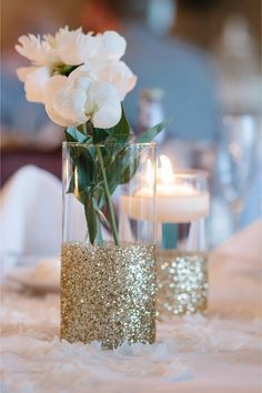 Gold Wedding centerpieces. Dip vases in glue and gold sparkles! Easy, beautiful DIY