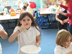 A pupil from Manorside Primary tucking in to her delicious tomato bruschetta!