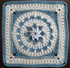 This absolutely beautiful square with such a stunning result is written for 3 colours of yarn, but is suitable for projects using more or fewer colours. The central flower is really beautiful and seems like the pattern's symmetry is just flowing from the central 3D flower. The pattern seems to flow so beautifully and well. …
