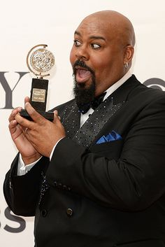 James Monroe Iglehart, winner of the 2014 Tony Award for the Best Performance by an Actor in a Featured Role in a Musical for 'Aladdin' pose...