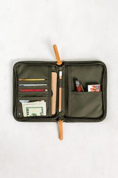 Perfect for storing your passport, license, and cards all in one place. Crafted from stain- and water-resistant recycled polyester with a DWR finish. If I Can Dream, Pouch, Wallet, Stationery Design, Vegetable Tanned Leather, Blue Bags, You Bag, All In One, Tan Leather