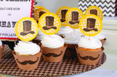 Rubber stamp a 'stache on plain paper or cardstock for some quick customized décor. That's how we made these simple (but adorable) cupcake wraps. Tip: The hats are stamped too. We cut them out and mounted them on contrasting paper.