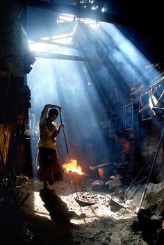 A man working in a cast-iron workshop  Khulna, Bangladesh