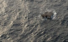 13 March 2011: A home is seen adrift in the Pacific Ocean, two days after the earthquake and tsunami