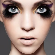 THOSE EYELASHES ARE GORGEOUS!! THE MAKEUP SEEMS TO MAKE THE MODEL EVEN MORE ADORABLE.