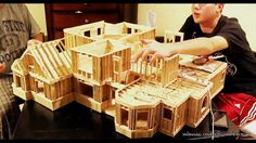 Making a mansion from popsicle sticks. I could do a tiny house me thinks.