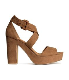 Sandals in imitation suede with peep toes. Adjustable wraparound strap with metal buckle at side. Rubber soles. Front platform height 1 1/4 in., heel height 4 1/2 in.