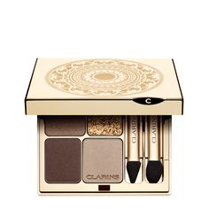 Limited Holiday Edition of Eye Quartet Mineral Palettein Odyssey. Striking gold!  Eyes are lit with golden shimmer in a mélange of coppery gold, brown, beige and taupe—brightened with mother-of-pearl highlighter for a gold leaf effect.