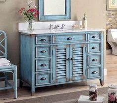 The plantation-inspired look of this Cottage/Beach style sink cabinet will add casual elegance to any bathroom decor. Classic cottage design details like shutter-style doors, this bathroom vanity offers a look that will create a relaxing retreat in a Blue Bathroom Vanity, Rustic Bathroom Vanities, Bathroom Furniture, Small Bathroom, Bathroom Ideas, Country Bathrooms, Bathroom Cabinets, Bathroom Designs, Blue Bathrooms