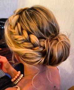 Side braid with a tucked in bun.