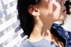 <p>You know what your earlobes need? Something <em>exactly</em> along these lines. The rectangular brass forms do a swift swerve at the base and curve up behind your lobes for what might just be the most badass-looking turns since Charlize Theron's <em>Mad Max</em> makeover.</p>