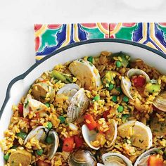 Paella is composed of rice, meat and vegetables. In Valencia, where it's said to have originated, paellas are almost always single-protein dishes. Here in America, however, we like to mix fish, chicken and pork. Throw in some vegetables and you have a complete good-for-you one-dish meal...