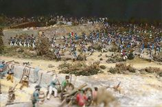 Feely said he often tore down parts of his diorama and rebuilt them as new information provided details about the March 6, 1836, morning battle. This scene shows the attack on the east wall by Mexican soldados under Col. José Maria Romero, with Texian defenders at a cannon station by the Alamo compound's cattle corral. Photo: Courtesy Photo / Courtesy Photo