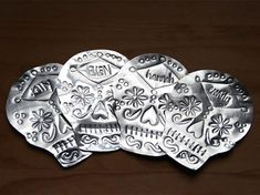 Mexican-Inspired Christmas Idea: DIY Hammered-Tin Sugar Skull Place Cards >> http://www.diynetwork.com/how-to/make-and-decorate/crafts/make-hammered-tin-sugar-skull-place-cards-pictures?soc=pinterest