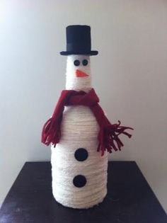 Liquor bottle snowman by JSStringDesigns on Etsy...$30.00