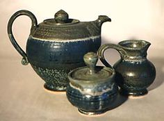 Stoneware teapot with cream and sugar by Don Dubois.