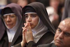 A nun prays after Communion as Pope Benedict XVI celebrates Mass Nov. 3 in St. Peter's Basilica