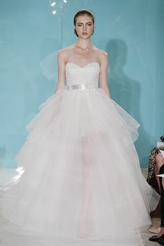 Reem Acra. These dresses make me wanna get married more than once. Or at least have more than one ceremony.