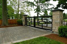 Exterior Designs Accessories and Furniture. Iron Gates Home Entrance. Two Black Swing Patterned Squared Main Entrance Iron Design Featuring Concrete Paving Block Floor Material. Iron Gates Home Entrance. Iron Gates Home Entrance