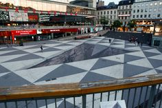 Mind Your Step - 3D Street Art by Erik Johansson at Sergels Square in the heart of Stockholm