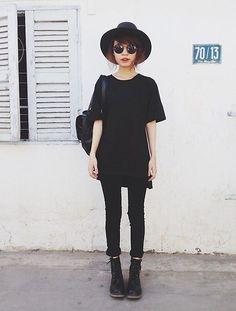 black tshirt, black jeans, black doc martens, black hat, black sunglasses, black bag