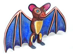 I have a Oaxacan bat, but not as colorful as this one.  Charming bat carving by  Eleazar Morales who is recognized for his talent in creating a wide variety of animals.