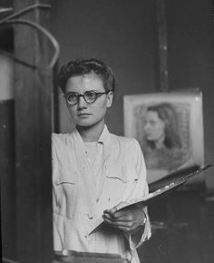 'A look of deep concentration radiates from this mid-40s artist's piercing eyes, housed behind round frames, as she concentrates on the picture she's painting.'  |  Chronically Vintage