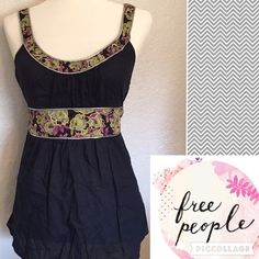 Free People Boho Peasant Top Amazing Detail Sz 12 Free People Boho Peasant Top size 12 100% cotton. Navy blue with silver trimming, green and purple floral print with copper and glass beaded embellishments throughout. The back boasts 6 corset style buttons adding to the detail and accentuating the silk ribbon tie. Gently worn Free People Tops Blouses