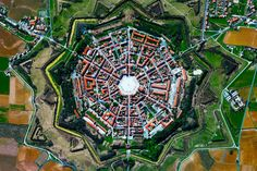 """The town of Palmanova, Italy, is recognized by its concentric layout known as a """"star fort."""" The rationale for this construction was that an attack on any individual wall could be defended from the. Earth Day Quiz, Photo Fruit, Star Fort, Aerial Images, Photo Couple, Earth From Space, Famous Landmarks, Birds Eye View, Photo Projects"""